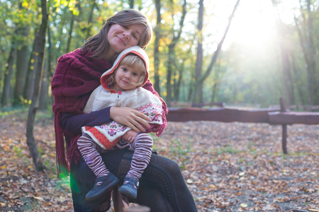 motherly: Portrait of a beautiful mother and her lovely little daughter. Stock Photo