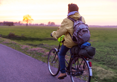 Man with backpack traveling by bicycle. Stock Photo
