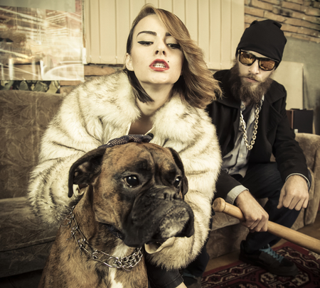 Strange family portait of rich couple and a strong pet. Stock Photo
