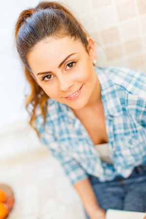 kindly: Portrait of a beautiful lady smiling kindly. Stock Photo