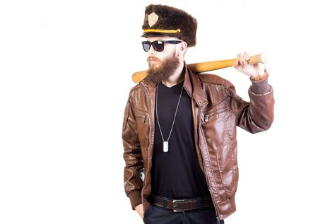 fake: Stylish hipster looking like an officer with cap and bat.