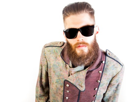weirdo: Man in strange outfit with sunglasses over isolated background.