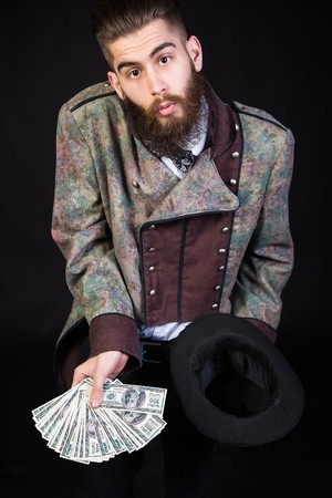 witchcraft: Wizard man making money with witchcraft.