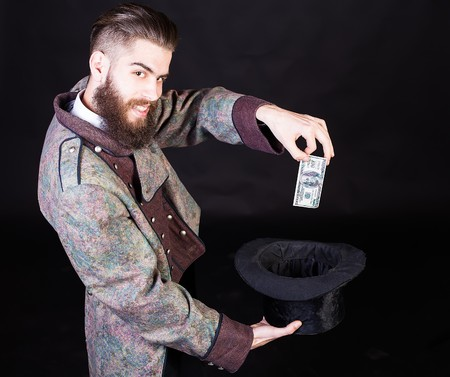 witchcraft: Sneaky wizard man making money with witchcraft.