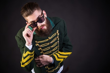 weirdo: Hipster man posing being awesome with sunglasses.