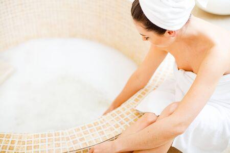Gorgeous woman having a foam bath alone.