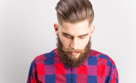 mustache: Handsome hipster guy with curly stylish mustache. Stock Photo