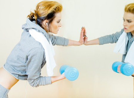 revitalizing: Young woman getting fit by going to the gym. Stock Photo