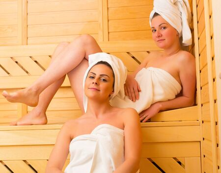 sexy gay: Female couple enjoying their well deserved sauna moments together.