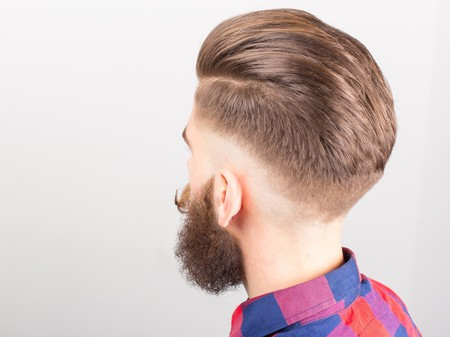 head wear: Shot of a hipster guy from behind. Stock Photo