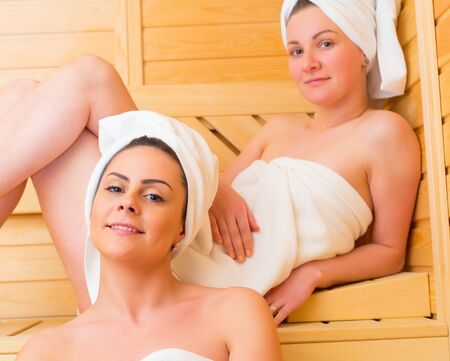 spacial: Gorgeous lesbian couple celebrating spacial moments in the sauna together.