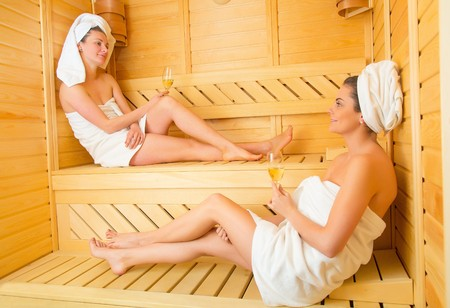 Gorgeous lesbian couple celebrating spacial moments in the sauna together.