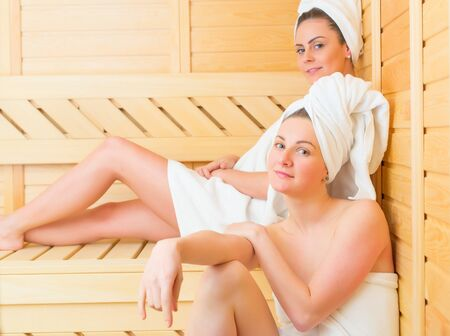 lesbian girls: Female couple enjoying their well deserved sauna moments together.