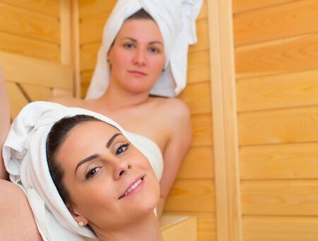 lesbian sexy: Spending spare time relaxing in the sweating room. Stock Photo