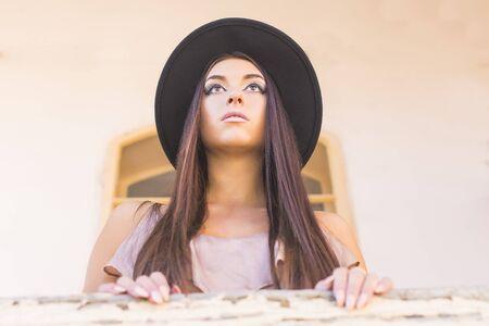 emotionless: Portait of an elegant beautiful woman in hat staring far away. Stock Photo