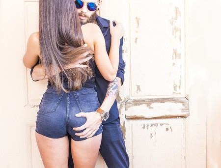 passionate embrace: Hipster couple  having an intimate moment very close to one another.