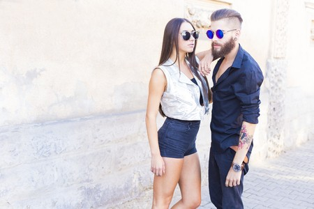 matching: Two elegant hipster people in sunglasses posing. Stock Photo