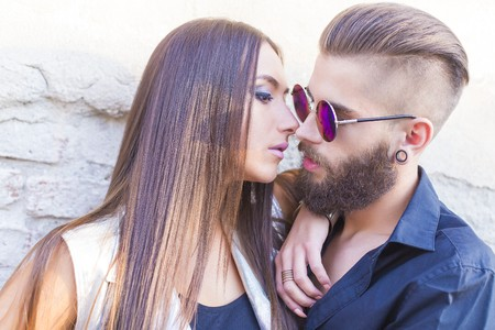 swag: Hipster couple having an intimate moment - kissing.