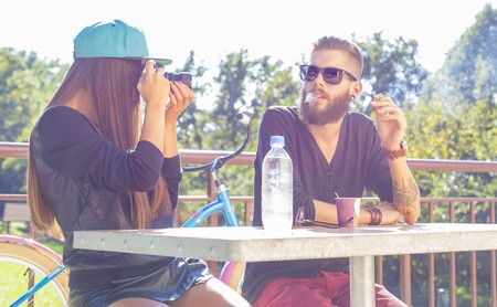 couple relaxing: Happy young people enjoying their time on the first date. Stock Photo