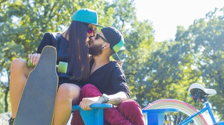 love kissing: Young happy lovers spending time together outdoors.