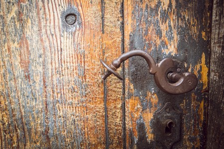 rusty door handle on an old door