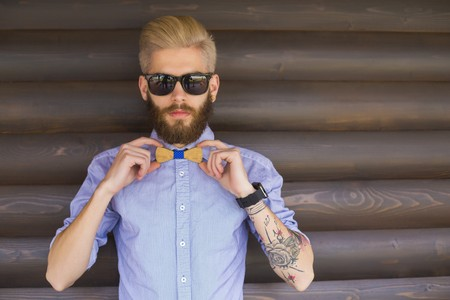 cool guy: Stylish young hipster guy showing off with cool hand gestures.