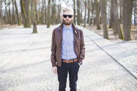 Hipster guy showing how to wear beard, hair and glasses with genuine style.