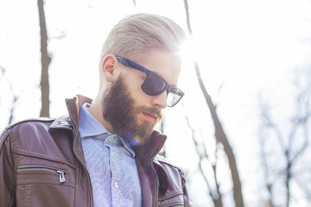 Portait of a stylish blond hipster man in shirt and fashionable glasses. Zdjęcie Seryjne