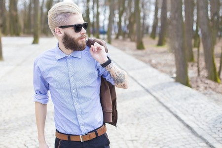 Fashionable young man representing the new generations hipster style.