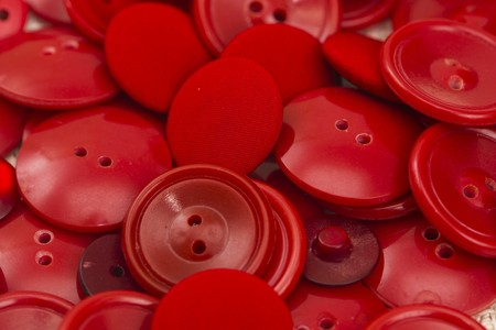 likeness: Close-up view of many red buttons on the table. Stock Photo