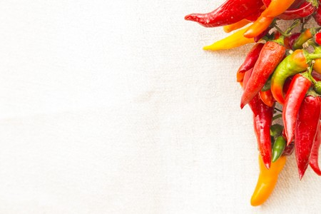 Bunch of chilly peppers on an empty surface - copy space. Stock Photo