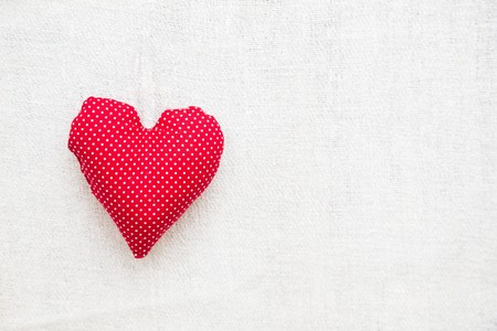 writing utensil: Heart shaped pillow over blank background - text area.