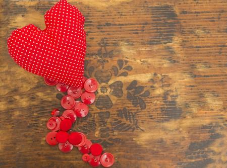 Tiny heart shaped needle pillow over blank background. Stock Photo