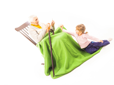 Old woman sitting on the chair with grandchildren