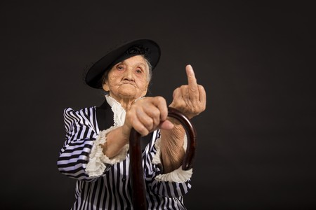 Old grandma in a white-black striped jacket