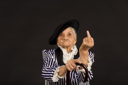 Old grandma in a white-black striped jacket Imagens