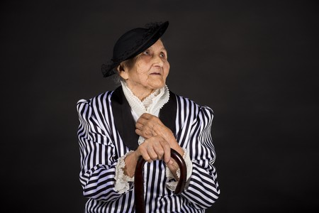 Old grandma in a white-black striped jacket Stock Photo