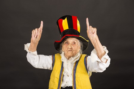 vintage old woman wearing cylinder and a yellow vest
