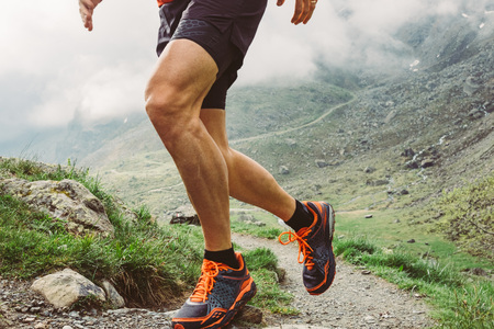 Man trail running in the mountains