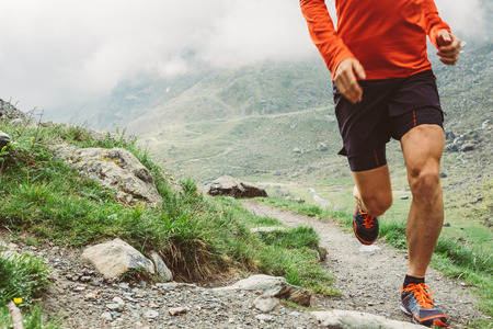 Man trail running in the mountains Stock Photo