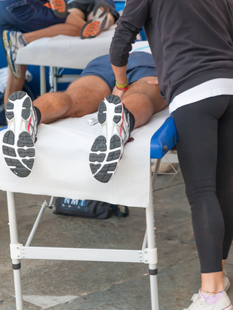 athletes relaxation massage before sport event, marathon muscles massage Stock Photo