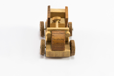 Wooden toy old car miniature isolated on white background photo