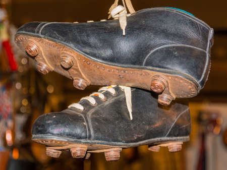 soccer sport: Close up of Vintage leather hanged black football shoes