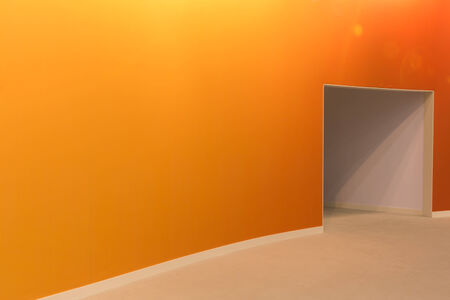 orange wall and open entrance in a empty room photo