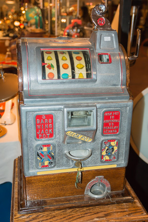 Close up of Vintage Nickel Slot Machine in excellent condition., modern art 20th century photo