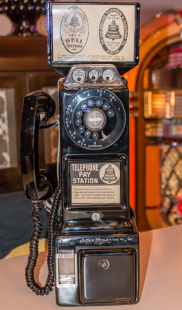 An old vintage pay black telephone photo
