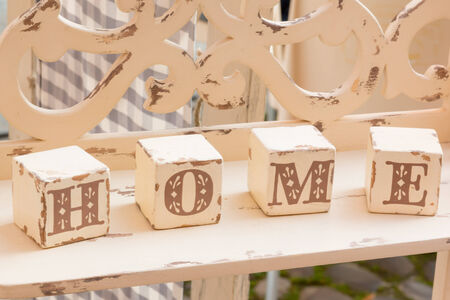 alphabetic: wooden old-looking cube decoration: home letters Stock Photo