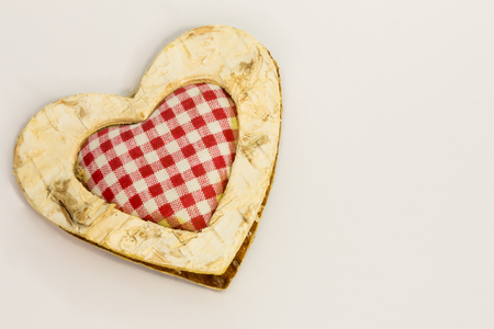 squared: wooden heart, squared textile in the middle
