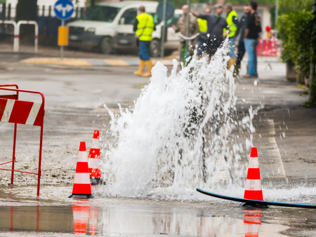 road spurt water beside traffic cones