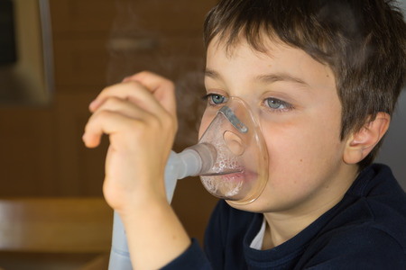 kid with mask for inhalations